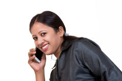 Indian executive talking over mobile casually Stock Images