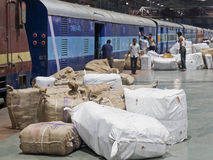 Indian express train being loaded with cargo Royalty Free Stock Photo