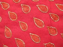 Indian Fabric. Beautiful thread and beads work on red crepe fabric Royalty Free Stock Photo