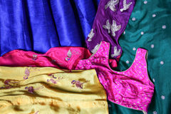 Indian fabric. Material of an indian dress with gold colored birds Royalty Free Stock Photography