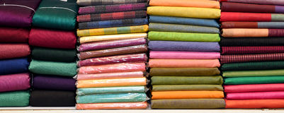 INDIAN FABRIC SAREES. Pile of colorful indian fabric sarees in the store royalty free stock images