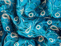 Indian fabric texture. Blue fabric with paisley ornament Stock Photo