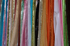 Indian fabrics. Colorful Indian fabric for sale on a market stall Stock Photos