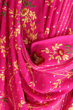 Indian fabrics. Pink indian fabrics in indian shop stock image