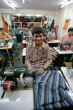 Indian factory. INDIA - FEB 26: Textile workers in a small factory in Old Delh on February 26, 2008 in Delhi, India. Many small factories provide the West with Royalty Free Stock Image
