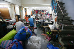 Indian factory. INDIA - FEB 26: Textile workers in a small factory in Old Delh on February 26, 2008 in Delhi, India. Many small factories provide the West with Royalty Free Stock Images
