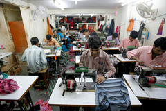 Indian factory. INDIA - FEB 26: Textile workers in a small factory in Old Delh on February 26, 2008 in Delhi, India. Many small factories provide the West with Royalty Free Stock Photos