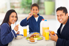 Indian family breakfast. Cheerful cute indian family enjoying their breakfast together stock photography