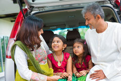 Indian family in car infront new house. Royalty Free Stock Image