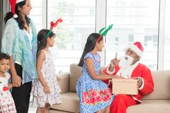 Indian family celebrating Christmas day royalty free stock photography