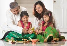 Indian family celebrating Diwali royalty free stock image