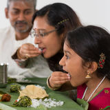 Indian family dining. At home. Candid photo of Asian people eating rice with hands. India culture stock images