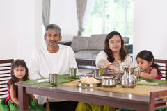 Indian family dining at home. Photo of India people eating rice on dining table. Traditional home cook meal stock photos