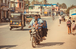 Indian family driving on a motorcycle through street of the city Stock Images