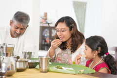 Indian family eating banana leaf rice Royalty Free Stock Photos