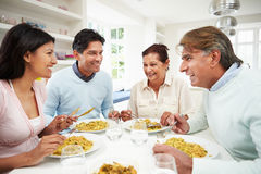 Indian Family Eating Meal At Home. Happy Indian Family Eating Meal At Home Smiling To Each Other Royalty Free Stock Photos