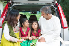 Indian family going to vacation. Happy Asian Indian family sitting in car talking and smiling happily, ready to summer vacation Stock Photos
