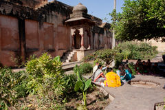 Indian family have rest in the old garden Royalty Free Stock Images
