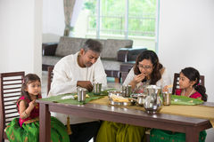 Indian family. Having a meal stock images