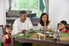Indian family having a meal. Photo stock image