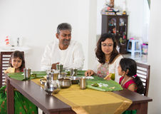 Indian family having a meal. Photo stock photo