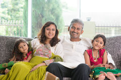 Indian family. At home. Asian parents and children living lifestyle, sitting on couch indoor smiling happily royalty free stock photos