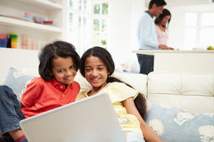 Indian Family With Laptop At Home Stock Photos