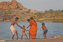 Indian family near the river Stock Images