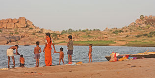 Indian family near the river Stock Photo