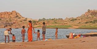 Indian family near the river. Tungabhadra river, Hampi, India Stock Photo