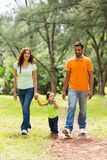 Indian family park. Happy young indian family walking in park Stock Photos