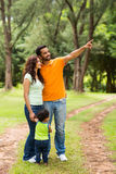 Indian family relaxing outdoors. Young indian family relaxing outdoors in forest Stock Photography