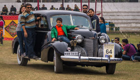 Indian family rides their Cadillac vintage car after flag off at the Statesman vintage car rally. Royalty Free Stock Photo
