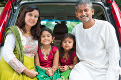 Indian family sitting in car. Royalty Free Stock Photography