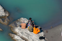 Indian family sitting on a rock at the River Ganga Royalty Free Stock Images
