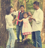 Indian family teaching. Children to climb Stock Image
