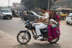 Indian family with two kids on motorcycle Stock Photography
