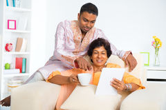Indian family using computer tablet Stock Photography
