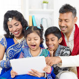 Indian family using digital computer tablet. At home. Asian family living lifestyle Stock Photos