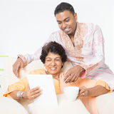 Indian family using mobile apps Stock Photos