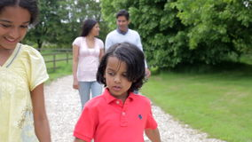 Indian Family Walking In Countryside Stock Photography