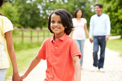 Indian Family Walking In Countryside royalty free stock image