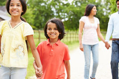 Indian Family Walking In Countryside Stock Photos