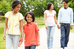 Indian Family Walking In Countryside stock images