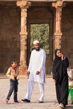 Indian family walking through courtyard of Quwwat-Ul-Islam mosqu Stock Photography