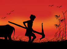 Indian Farmer at work. Silhouette of a farmer holding his ploughing tool and working in his field. this illustration features indian traditional farming with Stock Photos