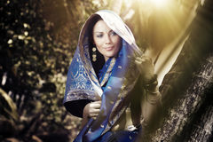 Indian fashion in sari. Beautiful lady outdoors in elegant sari standing in the wild jungle stock photos