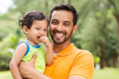 Indian father baby. Close up portrait of young indian father and baby boy outdoors Stock Images