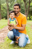 Indian father son. Happy indian father and son outdoors in forest Royalty Free Stock Photo