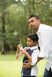 Indian father and son playing Stock Image